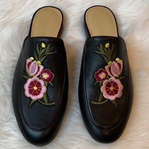 Marc Fisher black mules with embroidered f…